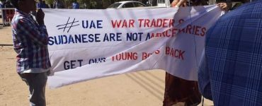 Sudanese protesters in front of the UAE embassy in Khartoum on Sunday (Twitter/@salma1siddig)
